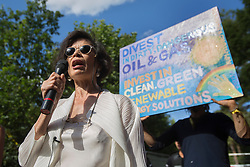 © licensed to London News Pictures. London, UK 03/08/2013. Bianca Jagger addressing the campaigners who protest against oil exploration in Balcombe, West Sussex on Saturday, August 03, 2013, a day after energy company Cuadrilla began drilling at the site. Photo credit: Tolga Akmen/LNP