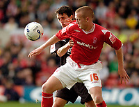 Photo: Leigh Quinnell.<br /> Nottingham Forest v Bristol City. Coca Cola League 1. 21/10/2006. Forests Sammy Clingan battles with Bristol Citys Craig Woodman.