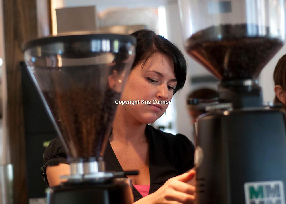 Portia Eastham makes coffee at Northside Coffee&Wine in Arlington, Va.