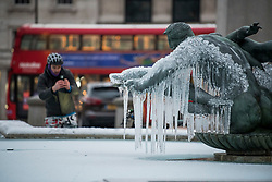 © Licensed to London News Pictures. 11/02/2021. London, UK. The fountains in Trafalgar Square, central London, frozen over following another night of sub zero temperatures in the capital. Photo credit: Ben Cawthra/LNP