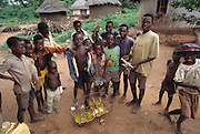 A group of South African village children play with a home made toy bus, ingeniously fashioned out of scrap wire. Tshamulavhu village, Mpumalanga, South Africa. Image from the book project Man Eating Bugs: The Art and Science of Eating Insects.