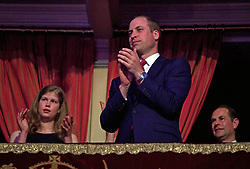 The Duke of Cambridge applauds Queen Elizabeth II as she takes the stage at the Royal Albert Hall in London for a star-studded concert to celebrate the Queen's 92nd birthday.