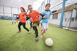 20 February 2020, Za'atari Camp, Jordan: Players compete for the ball during football practice for girls in the Peace Oasis, a Lutheran World Federation space in the Za'atari Camp where Syrian refugees are offered a variety of activities on psychosocial support, including counselling, life skills trainings and other activities.