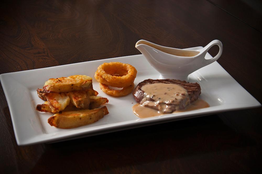 Fillet steak, handmade chips, onion rings and peppercorn sauce.