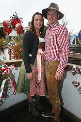06.10.2013, Kaefers Wiesenschaenke, Muenchen, GER, der FC Bayern Muenchen beim Oktoberfest, im Bild Toni Kroos of Bayern Muenchen poses with Jessica Farbe in front of the ensemble of the Bavaria statue, a monumental bronze sand-cast 19th-century statue and the Hall of Fame (Ruhmeshalle). The Bavaria is the female personification of the Bavarian homeland and by extension its strength and glory // during the Oktoberfest 2013 beer festival at Kaefers Wiesenschaenke in Munich, Germany on 2013/10/06. EXPA Pictures © 2013, PhotoCredit: EXPA/ Eibner/ Eckhard Eibner<br /> <br /> ***** ATTENTION - OUT OF GER *****