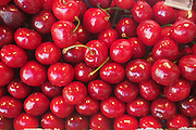 A stack of ripe, fresh red cherries