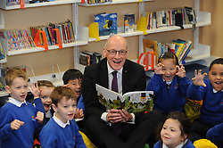 Pictured: John Swinney<br /> <br /> Deputy First Minister John Swinney celebrated Book Week Scotland today as he visited Forthview Primary School in Edinburgh. The minister visited the school library to see Primary 2 pupils exploring their new Read, Write, Count gift bags. The scheme was launched by the Scottish Government in 2015 to give support to parents and carers to help them get involved in their child's learning<br /> <br /> Dave Johnston   EEm 29 November 2017