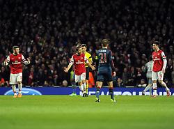 Arsenal's Mathieu Flamini and Arsenal's Jack Wilshere raleigh the troops - Photo mandatory by-line: Joe Meredith/JMP - Tel: Mobile: 07966 386802 19/02/2014 - SPORT - FOOTBALL - London - Emirates Stadium - Arsenal v Bayern Munich - Champions League - Last 16 - First Leg