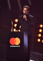 Michael C. Hall collecting the Best British Male Award on behalf of the late David Bowie on stage at the BRIT Awards 2017, held at The O2 Arena, in London.<br /><br />Picture date Tuesday February 22, 2017. Picture credit should read Matt Crossick/ EMPICS Entertainment. Editorial Use Only - No Merchandise.