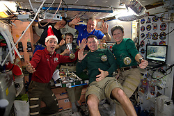 French cosmonaut Thomas Pesquet (left) celebrates Christmas dinner with other colleagues on board International Space Station, on December 24, 2016. Photo by ESA via Balkis Press/ABACAPRESS.COM