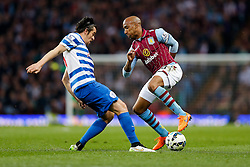 Fabian Delph of Aston Villa is challenged by Joey Barton of QPR - Photo mandatory by-line: Rogan Thomson/JMP - 07966 386802 - 07/04/2015 - SPORT - FOOTBALL - Birmingham, England - Villa Park - Aston Villa v Queens Park Rangers - Barclays Premier League.