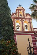 Church bell tower against blue sky, Iglesia de San Augustin, Malaga, Spain