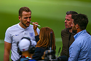 England forward Harry Kane (Tottenham) is prepared with make up before giving an interview during the England walk around the pitch ahead of the Nations League Semi-Final against Holland at Estadio D. Afonso Henriques, Guimaraes, Portugal on 5 June 2019.