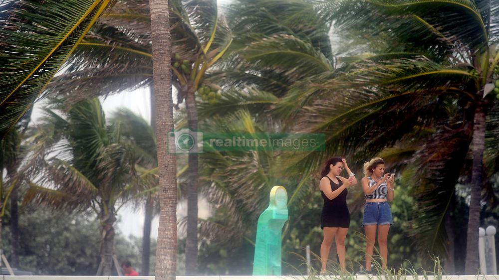 Maria Pogo, left, and Zayra Carpio, friends who live in Plantation, FL, USA., take photographs on Fort Lauderdale Beach as Hurricane Irma pushes into South Florida on Saturday, September 9, 2017. Photo by Amy Beth Bennett/Sun Sentinel/TNS/ABACAPRESS.COM