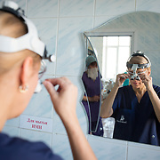 CAPTION: Maxillofacial surgeon Dr Fomenko adjusts her surgical loupes, purchased with SmileTrain support, prior to performing her next surgery. LOCATION: Volgograd City Hospital #1, Volgograd, Russia. INDIVIDUAL(S) PHOTOGRAPHED: Dr Irena Fomenko.