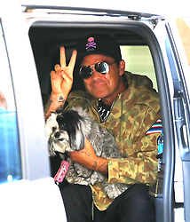 Robbie Williams wishes Manchester peace as he leaves his Manchester hotel on Wednesday afternoon to head to The Etihad Stadium to sound check for his upcoming gigs.