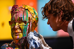 "© Licensed to London News Pictures. 14/09/2018. LONDON, UK. A technician inspects ""Bust of Frank"", 2007-10, by Damien Hirst (Est. GBP25,000-35,000) at a preview of the ""Yellow Ball: The Frank and Lorna Dunphy Collection"" sale at Sotheby's in New Bond Street.  Frank Dunphy was Damien Hirst's former business manager and mentor.  Over 200 works will be auctioned by Sotheby's on 20 September 2018.  Photo credit: Stephen Chung/LNP"