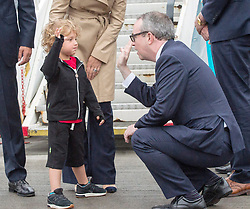Hadrien Trudeau, son of Prime Minister Justin Trudeau gives a high five to Jim Kelly, Ambassador of Ireland to Canada, as they land in Dublin, Ireland on Monday, July 3, 2017. Photo by Ryan Remiorz/CP/ABACAPRESS.COM