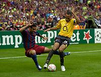 Photo: Richard Lane.<br />Arsenal v Barcelona. UEFA Champions League Final. 17/05/2006.<br />Arsenal's Thierry Henry challenges Rafael Marquez.