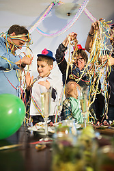 Guests with paper streamers at a party