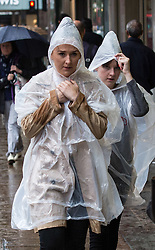 © Licensed to London News Pictures. 26/07/2015. London, UK. People enduring wet weather on Oxford Street in central London.  Photo credit : James Gourley/LNP