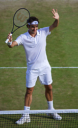 04.07.2014, All England Lawn Tennis Club, London, ENG, ATP Tour, Wimbledon, im Bild Roger Federer (SUI) celebrates after winning the Gentlemen's Singles Semi-Final match 6-4, 6-4, 6-4 on day eleven // during the Wimbledon Championships at the All England Lawn Tennis Club in London, Great Britain on 2014/07/04. EXPA Pictures © 2014, PhotoCredit: EXPA/ Propagandaphoto/ David Rawcliffe<br /> <br /> *****ATTENTION - OUT of ENG, GBR*****