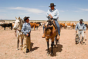07 MAY  2004 -- WILLIAMS, AZ: Cowboys talk about their herd of  cattle in a corral  on the Willaha Ranch, north of Williams, AZ, May 7, 2004. The ranch is in the high desert country near the south rim of the Grand Canyon. The ranch is in the high desert country near the south rim of the Grand Canyon. Arizona ranchers are in the midst of a ten year draught that has dramatically reduced the size of their herds. At the same time, public consumption of beef has soared because of the popularity of the Atkins and other high protein diets, so while prices are up, herd yields are down because of the drought.  PHOTO BY JACK KURTZ