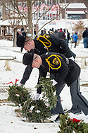 Goshen, New York - Two Orange County Sheriff's deputies place wreaths at graves during a Wreaths Across America ceremony at Orange County Veterans Memorial Cemetery on Dec. 16, 2017. About 3,000 wreaths were placed at graves, and small American flags were added to the wreaths at veterans' graves.