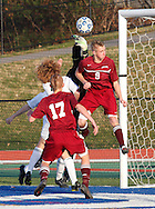 Fort Ann's Garrett Bailey (9)  leaps to  head the ball as teammate Nick Lehoisky looks on during the Class D state semifinals at Faller Field in Middletown on Saturday. Nov. 16, 2013. Lehosky socred seconds later. (Tom Bushey – Special to The Post-Star)