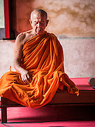 27 JUNE 2015 - BANGKOK, THAILAND:  A Buddhist monk meditates in the Wiharn (prayer hall) at Wat Kamphaeng near Khlong Bang Luang. The Bang Luang neighborhood lines Khlong (Canal) Bang Luang in the Thonburi section of Bangkok on the west side of Chao Phraya River. It was established in the late 18th Century by King Taksin the Great after the Burmese sacked the Siamese capital of Ayutthaya. The neighborhood, like most of Thonburi, is relatively undeveloped and still criss crossed by the canals which once made Bangkok famous. It's now a popular day trip from central Bangkok and offers a glimpse into what the city used to be like.       PHOTO BY JACK KURTZ