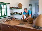 Potter at work, Museum and folklore arts centre, Casa Museo Monumento al Campesino, Lanzarote, Canary Islands, Spain