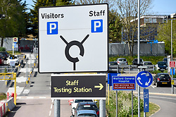 © Licensed to London News Pictures. 26/04/2020. WATFORD, UK. A sign directs drivers to a testing centre which opened in the car park of Watford General Hospital on 23 April.  Those eligible to use the test centre are hospital staff members or their household who are symptomatic of Covid 19.  To accelerate the testing programme towards a target of 100,000 tests per day by 30 April set by Matt Hancock, Health Secretary, many more testing centre have been set up in the last few days including mobile pop-up test centres. Photo credit: Stephen Chung/LNP