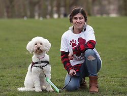 Sarah Mohammadi, 14, from Hayes in west London, with her Cocker Spaniel/Poodle cross Waffle, during a photocall by The Kennel Club in Green Park, London, to announce the finalists for the Crufts dog hero competition, Friends for Life 2018.
