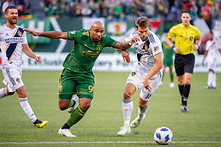 June 15, 2018 - Portland, Oregon, U.S. - PORTLAND, OR - JUNE 15: Portland Timbers forward Samuel Armenteros  attemps to dribble past LA Galaxy defender JÂ¿rgen Skjelvik during the Portland Timbers game versus the LA Galaxy in a United States Open Cup match on June 15, 2018, at Providence Park, OR. (Photo by Diego G Diaz/Icon Sportswire) (Credit Image: © Diego Diaz/Icon SMI via ZUMA Press)