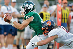 {BLOOMINGTON, IL: Dean Zigulich catches the flee flicker from Bryce Dooley and is stopped just short of the goal by Corey Kennedy during a college football game between the IWU Titans  and the Wheaton Thunder on September 15 2018 at Wilder Field in Tucci Stadium in Bloomington, IL. (Photo by Alan Look)