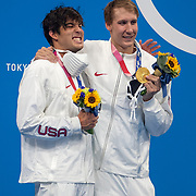 TOKYO, JAPAN - JULY 25: Chase Kalisz of the United States winner of the the gold medal with team mate Jay Litherland of the United States winner of the silver medal in the 400m Individual Medley Final for men during the Swimming Finals at the Tokyo Aquatic Centre at the Tokyo 2020 Summer Olympic Games on July 25, 2021 in Tokyo, Japan. (Photo by Tim Clayton/Corbis via Getty Images)