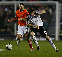 Photo: Steve Bond/Richard Lane Photography. Derby County v Blackpool. Coca-Cola Championship. 26/12/2009. Chris Porter (R) is muscled off the ball by Gary Taylor-Fletcher (L)