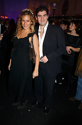 CHARLOTTE DELLAL and ZAFAR RUSHDIE at a party to celebrate the launch of a range of leather accessories designed by Giles Deacon for Mulberry held at Harvey Nichols, Knightsbridge, London on 30th October 2007.<br />