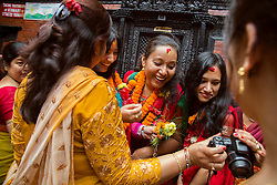 """Seven retired Royal Kumaris are honored inside Kathmandu Durbar Square in the morning of the final day of Kumāri Jātrā, where the Royal Kumari is taken around the city in a chariot procession among thousands of the country's Hindus and Nepali Buddhists. The word Kumari literally means """"virgin"""" in Nepali. These living goddesses are young, pre-pubescent girls who are considered to be incarnations of the Hindu goddess of power, Kali.  <br /> <br /> Contract for story is Kashinath Tamot, kashinath.tamot@nepalmandal.org and Sangeeta Lama, sangeetala@gmail.com ."""