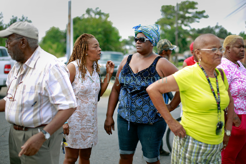 29 August 2014. Lower 9th Ward, New Orleans, Louisiana.<br /> Residents and hurricane Katrina survivors gather at the official memorial in remembrance of the day Hurricane Katrina swamped the community 9 years ago today..<br /> Photo; Charlie Varley/varleypix.com