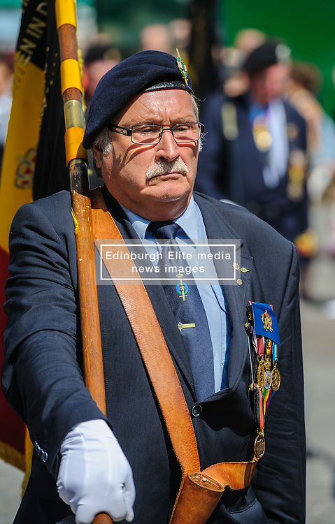 A World War 2 veteran marches behind a band in the Grote Markt, Bruges, Belgium as part of the celebrations of Belgium's National Day on 22nd July.<br /> <br /> (c) Andrew Wilson   Edinburgh Elite media