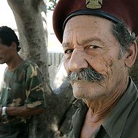 3rd August 2006&#xD;&#xA;Tyre, Lebanon&#xD;&#xA;Refugee Camp&#xD;&#xA;A veteran of previous conflicts in Lebanon who now works as a guard at the Rashidiyeh Camp on the outskirts of Tyre which has become home not only to Palestinian refugees but also the Lebanese people who have fled the towns and villages due to Israeli air strikes The two groups now live side by side and are struggling together through the food and fuel shortages caused by this conflict.<br />
