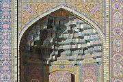 Ceramic tiles ceiling decorating a vault at Nasir al-Mulk Mosque, (aka the Pink Mosque) Shiraz, Iran. Built 1876 -1888. Architects: Muhammad Hasan-e-Memar and Muhammad Reza Kashi Paz-e-Shirazi.
