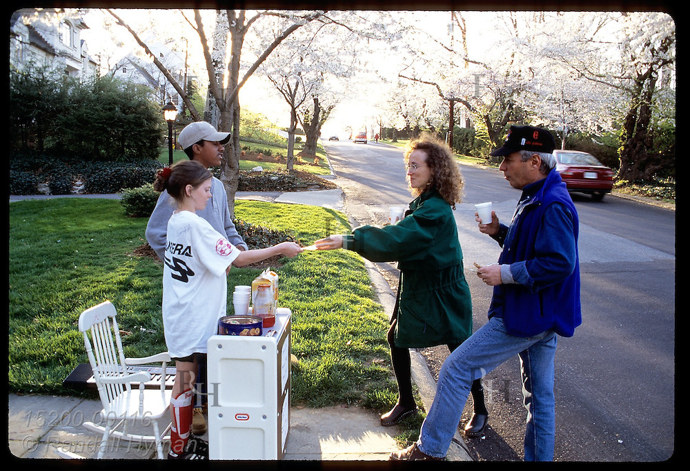 Resident teens sell juice & cookies to tourists admiring cherry blossoms @ Kenwood; Bethesda, Maryland