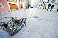 'Cumil', by Viktor Hulik, one of several humorous statues which grace the streets of the Slovak capital, Bratislava, Slovakia