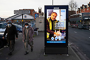 Public Health England NHS sign advising hand washing while the second national lockdown continues with just a week before the new three tier system begins, people wearing face masks out and about in Sparkhill on the border with Sparkbrook as all non-essential shops are closed on 24th November 2020 in Birmingham, United Kingdom. The national lockdown is a huge blow to the economy and for individual businesses who were already struggling with only offering limited services.