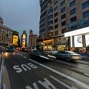 Madrid, Spain - February 15, 2018 - … along Gran Via near Cines Capitol and Cines Calle.<br /> <br /> Image: © Rod Mountain<br /> <br /> http://www.rodmountain.com <br /> <br /> Instagram<br /> @spain @visita_madrid @cinescallao<br /> <br /> FaceBook<br /> @spain.info @visitamadridoficial @CinesCallao<br /> <br /> Twitter<br /> @spain @Visita_Madrid @cines_callao<br /> <br /> https://www.capitolgranvia.com<br /> https://cinescallao.es<br /> https://www.esmadrid.com/en<br /> https://en.wikipedia.org/wiki/Madrid<br /> https://www.spain.info/en/que-quieres/ciudades-pueblos/grandes-ciudades/madrid.html<br /> <br /> #citynights #urbannight #evening #nightfall #atnightzine #cityshotmag #adorenoir #HonestFrames #ArtofVisuals #shotaroundmag #photooftheday #spaintravel #VisitSpain #photojournalism #everydaymadrid #postcardsfromtheworld #photographyislife #ourplanetdaily #momentsofmine #getoutstayout #illgrammers#instamagazine #storyofthestreet #streetleaks #streetphoto #bnw_captures #bnw_life #blackandwhite_perfection #bnw_planet #blackandwhiteisworththefight