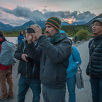 A photography seminar shoot pictures at dusk beside Vermillion Lakes in Banff National Park, Alberta, Canada.