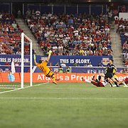 Patrick Mullins, NYCFC, scores for his side beating goalkeeper Luis Robles, New York Red Bulls, during the New York Red Bulls Vs NYCFC, MLS regular season match at Red Bull Arena, Harrison, New Jersey. USA. 10th May 2015. Photo Tim Clayton