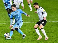 Football - 2020 / 2021 Sky Bet Championship - Swansea City vs Coventry City - Liberty Stadium<br /> <br /> Callum O'Har of Coventry Citye of Coventry City on the ball Matt Grimes Swansea defends <br /> <br /> COLORSPORT/WINSTON BYNORTH